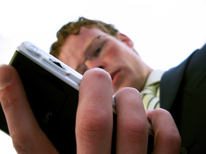 Young Businessman with Smartphone in Hand